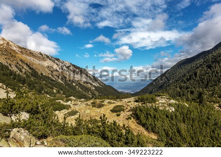 Beautiful bright contrasting mountain landscape with mountain tops covered with forest and cloudy sky. Balkan Mountains, Bulgaria, Europe - stock photo
