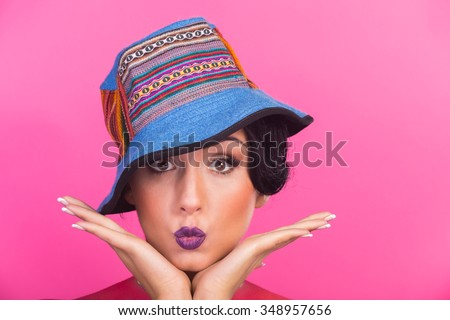 Beautiful, bright creative make-up girl. Funny brunette in a hat. The emotional, vivid image of the girl. - stock photo