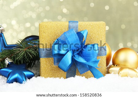 Beautiful bright gift and christmas decor, on shiny background