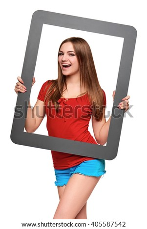 Beautiful bright girl standing looking through the frame, over white background - stock photo