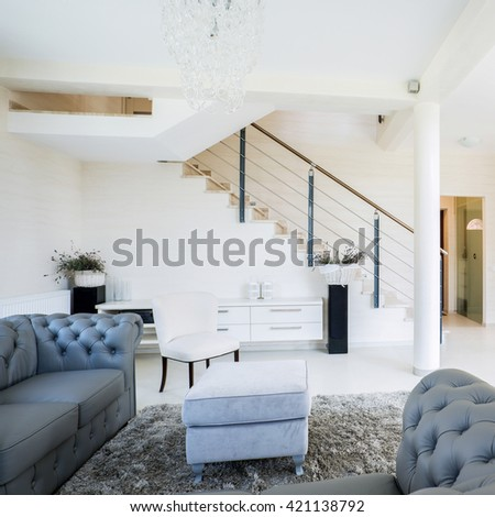 Beautiful, bright living space with modern fireplace - stock photo