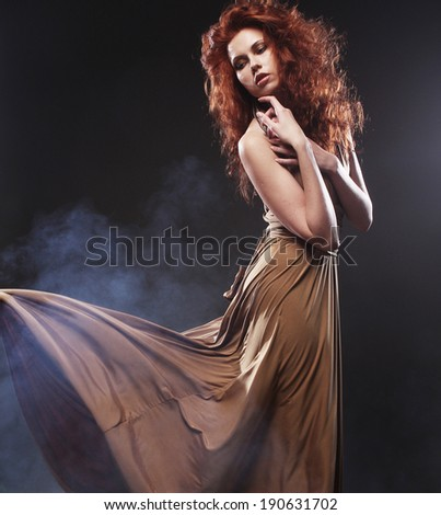beautiful bright red hair woman in long dress   - stock photo