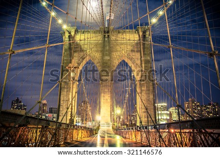 Beautiful Brooklyn Bridge in New York City seen at night from the pedestrian walkway - stock photo