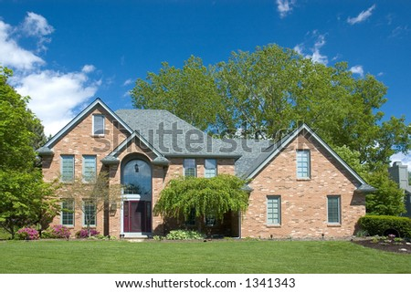 Beautiful brown two story new home. Typical home in the suburbs of the United States. Just one of many home or house photos in my gallery. - stock photo