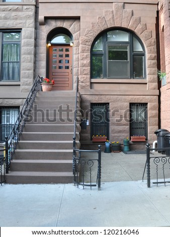 Beautiful Brownstone Home Steps to Entrance Doorway - stock photo