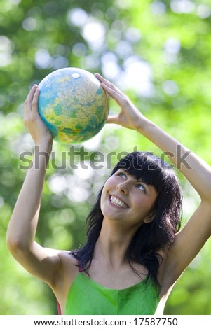 beautiful brunet woman with global - stock photo