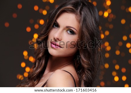 Beautiful brunette at new year party celebration