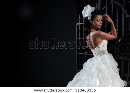 Beautiful brunette bride in black background. copy space.