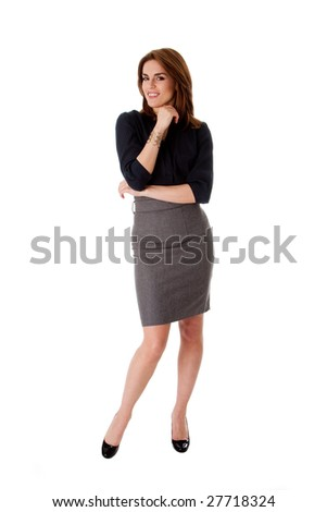 Beautiful brunette business woman standing wearing gray skirt and blue blouse with hand on chin, isolated