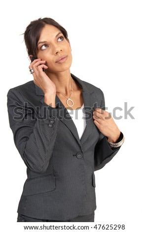 Beautiful brunette businesswoman in pinstripe suit talking on her cellphone. Isolated on white background with copy space - stock photo