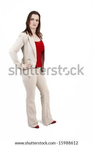 Beautiful brunette businesswoman wearing a beige jacket and a red top. Isolated on white background with copy space - stock photo