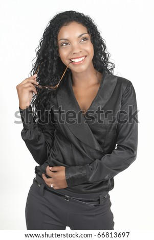 Beautiful brunette businesswoman wearing office clothes holding reading glasses in her hand. On white background with copy space - stock photo