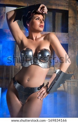 Beautiful brunette dressed as a fantasy warrior - stock photo