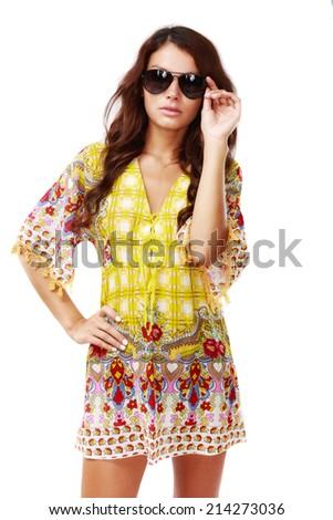 Beautiful brunette female in summer dress over white background - stock photo