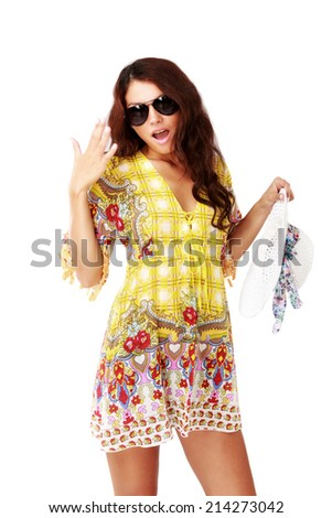 Beautiful brunette female in summer dress over white background