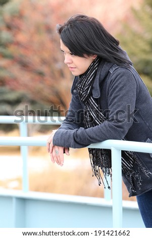 Beautiful brunette female outside on a cold winters day - stock photo