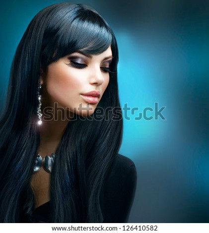 Beautiful Brunette Girl. Healthy Long Hair and Holiday Makeup. Jewelry. Jewellery - stock photo