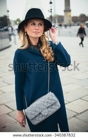 Beautiful brunette girl in casual clothes walking around the city. Fashion and city style.