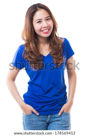Beautiful brunette girl in jeans and blue t-shirt smiling very happy  on white background - stock photo