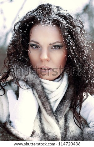 beautiful brunette girl in the snow
