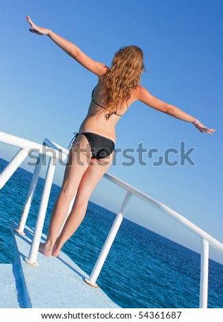 beautiful brunette girl on speed boat in sunny day