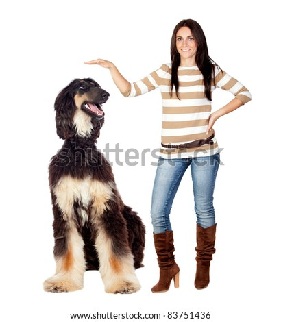 Beautiful brunette girl with a big dog isolated on a over white background