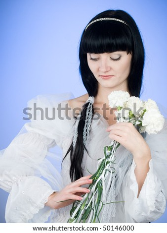 beautiful brunette girl with flowers on blue background