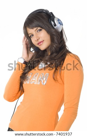 Beautiful brunette girl with headphones listening music and playing. Nice orange shirt. - stock photo