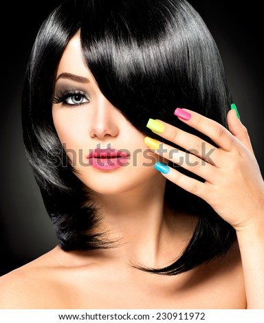 Beautiful Brunette Girl with Healthy Black Hair, haircut. Colorful manicured nails Isolated on Black background. Beauty Woman with Short Black Hair - stock photo
