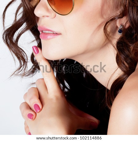 Beautiful brunette girl with healthy hair in studio - stock photo