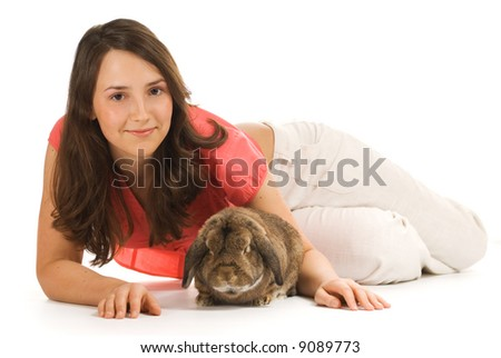 Beautiful brunette girl with rabbit isolated on white background