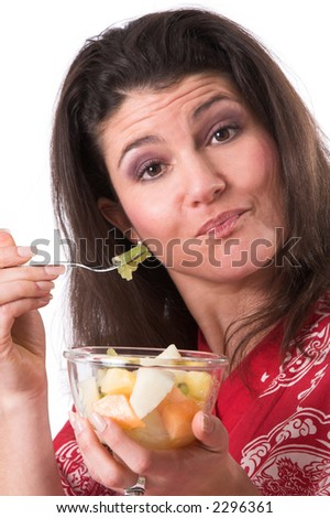 beautiful brunette having a healthy bowl of fruit as a snack - stock photo