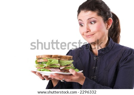 beautiful brunette holding a plate with a healthy sandwich in her hands