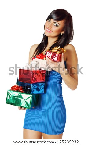 beautiful brunette holding a stack of gifts