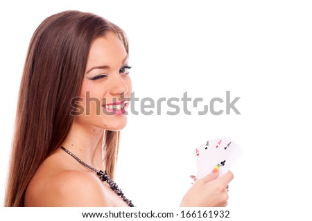Beautiful brunette holding four aces in her hand and winking - all aces in my hands, isolated on white  - stock photo