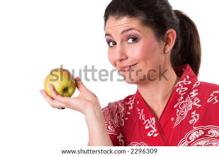 Beautiful brunette holding up an apple to indicate a healthy lifestyle - stock photo