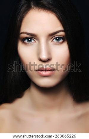 beautiful brunette in studio. portrait. skin care