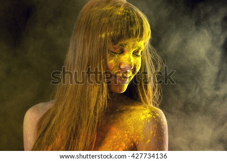 beautiful brunette in yellow colors Holi