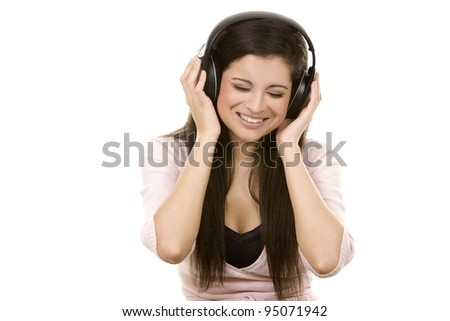beautiful brunette listening to music on white background