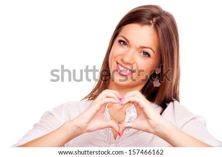 Beautiful brunette make heart with fingers, isolated on white - stock photo