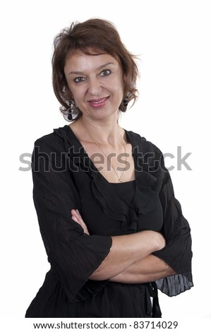 beautiful brunette mature woman smiling with black dress - stock photo