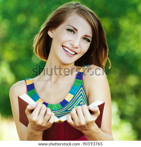 beautiful brunette penalty park reading book smiling