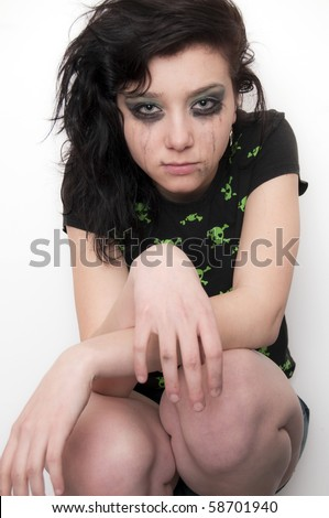 Beautiful Brunette Rocker Gril Crying - stock photo