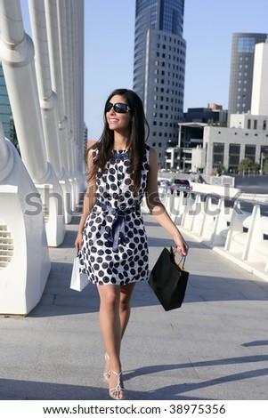 Beautiful brunette shopaholic outdoor modern city urban street - stock photo