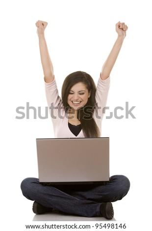 beautiful brunette sitting down holding laptop on white background - stock photo