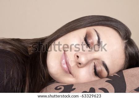 Beautiful brunette sleeping - stock photo