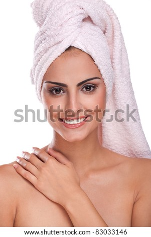 Beautiful brunette spa woman in the morning in towel on head - stock photo