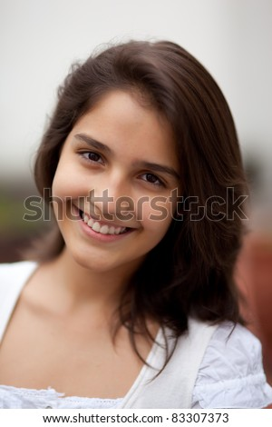 Beautiful brunette teenage girl. Nice bokeh. Very shallow depth of field. - stock photo