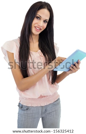 Beautiful brunette using tablet pc on white background