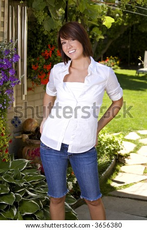 beautiful brunette wearing white shirt and blue jeans